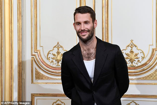 4561002-6209797-French_designer_Simon_Porte_Jacquemus_has_become_the_toast_of_th-a-1_1538056067465.jpg